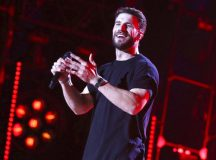 "FILE - In this June 9, 2017 file photo, Sam Hunt performs at the 2017 CMA Music Festival in Nashville, Tenn. Hunt's ""Body Like a Back Road"" was named as one of the top songs of the year by the Associated Press. (Photo by Laura Roberts/Invision/AP)"